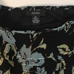 Alfani Skirts - ⬇️$16 Alfa I floral full skirt. Size 4.